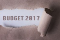 torn paper with BUDGET 2017 word. Copyspace area