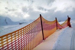 muzzle red grid on a ski slope in  evening.
