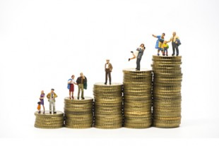 Faily budget concept. Miniature family on coins pile.
