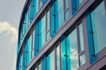 Blue brise soleil sun breakers on modern office glass building