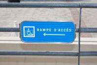 Blue handicap parking or wheelchair parking space sign - vector