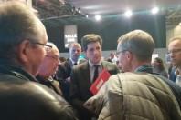Julien Denormandie, secrétaire d'Etat auprès du ministre de la cohésion des territoires, avec des élus locaux au Congrès des maires, le 22 novembre