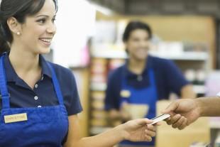 Handing Loyalty Card In Supermarket