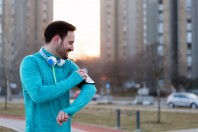 Young fitness man running in urban area