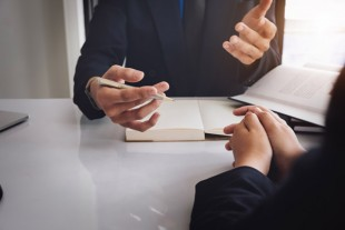 notary consultant concept , Judge gavel with client negotiation