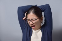 Asian Glasses Woman Yawning.