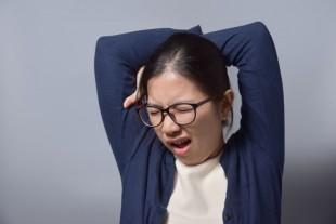 Asian Glasses Woman Yawning.