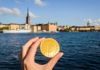 Sweden chocolate coins with Stockholm on blurred background