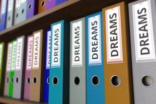 Office binders with DREAMS inscription. 3D rendering