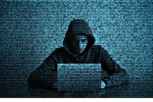 Hacker in data security concept. Hacker using laptop. Hacking th