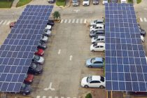 Parking lot with solar panel on roof aerial above view