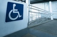 Concret ramp way with stainless steel handrail with disabled sign for support wheelchair disabled people.