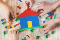 Build a designer Lego house. Selective background. play