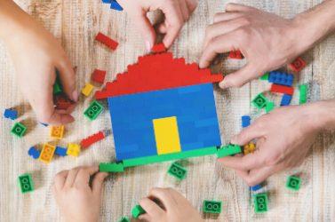 Build a designer Lego house. Selective background. play