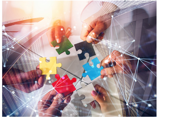 Business team connect pieces of puzzles. Teamwork, partnership a