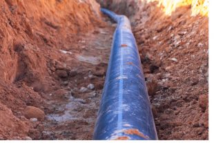 A black plastic pipe with a blue strip to feed water to the hous