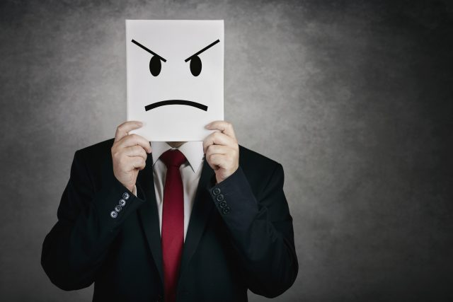 angry man with white board on gray background