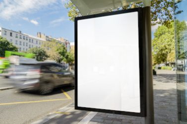 Outdoor bus stop advertisement mockup with cars
