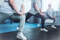 Close up look on retired women lunging at fitness club