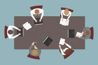 Teamwork. Top view of employees working at table. Vector.