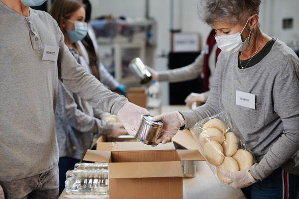 Group of volunteers in community donation center, food bank and