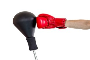 hand with glove punch a punching ball on white background