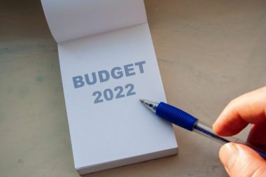 Budget 2022 word on white paper note and pen. Financial concept
