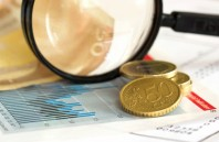 Finance: Price index graph magnifying glass and euro currency