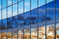 Modern metal and glass wall with bright reflections