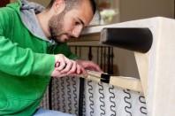 Man repairing a sofa