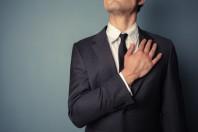 Businessman swearing allegiance